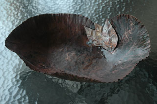 larger bowl with leaves