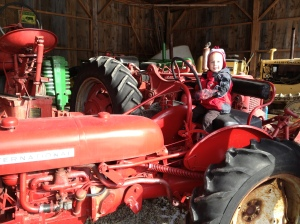 Nathaniel on Mr Tucker's tractor